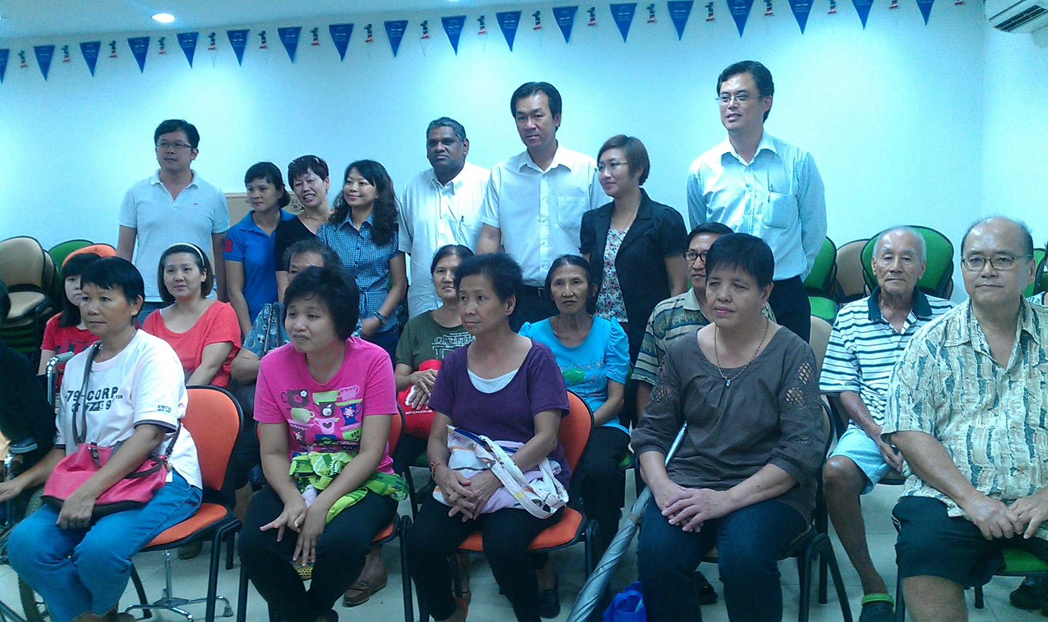 Tan, Yap and Tnay with the people they helped.