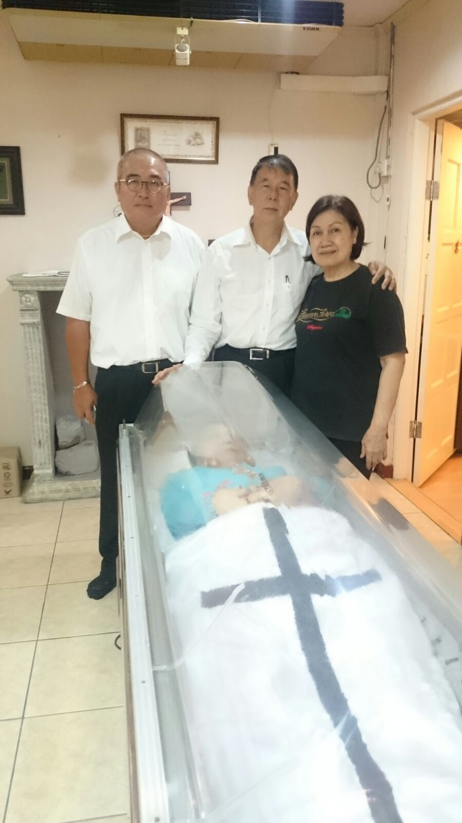 Dato Sebastian and Adam with Theresa paying the last respect to her mother.