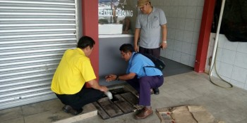 SUPP PCB Chief and candidate for N12 Kota Sentosa Wilfred Yap at the site of the blocked drains