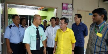 Dr Sim with Francis Harden visiting the hospital.