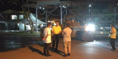 SUPP PCB Chief, Wilfred Yap at the site of the resurfacing works being carried out at night in Kota Sentosa Commercial area