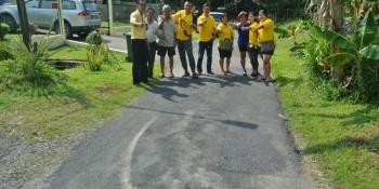 SUPP PCB Chief Wilfred Yap with SUPP members and residents of Lorong 41, Stampin Resettlement Scheme inspecting the repaired road and SUPP PCB Chief Wilfred Yap inspecting the newly painted road at the entrance of Lorong 2, Stampin Resettlement Scheme