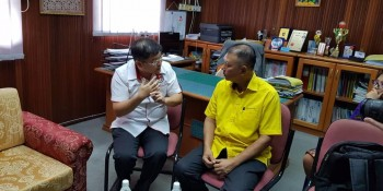 Ting  in a discussion with Dr. Jack Wong