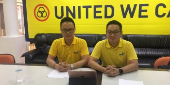 Michael Tiang and Milton Foo at the press conference