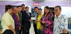 Giving financial grant to respective schools