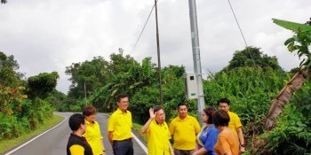 Dr Sim looking at the new street lights.