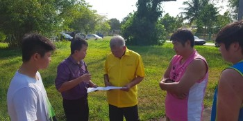 Datuk Sebastian Ting looking at the plan of the shed