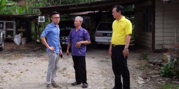 Yap with Mr Tan and the representative of the company discussing on how best to settle the predicament of Mr Tan on the closure of the only access road to the Mr Tan's wooden house.