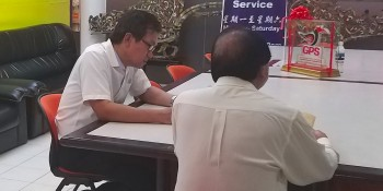 Yap together with the father seeking assistance on his daughter's problem  at SUPP office.