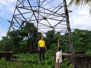 Yap andMr Tan at the site of Tower Base of the transmission tower.