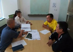 Yap and  Mr Tan during the meeting with officers of the power utility company.
